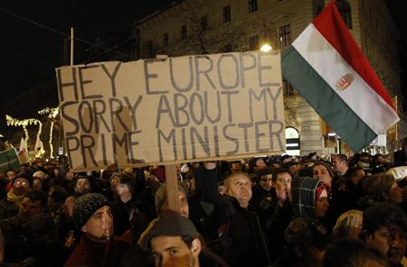 A man holds up a sign during a protest in central Budapest.